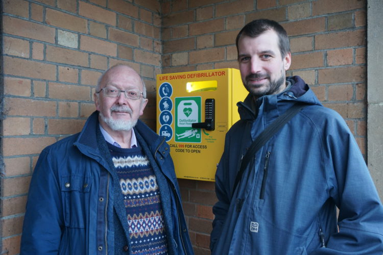 Cllr Jonny Crawshaw and John Sparrow unveiling the new AED.